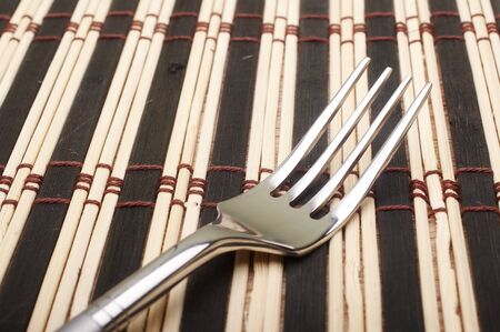 placemats: Closeup fork on placemats on dining table Stock Photo