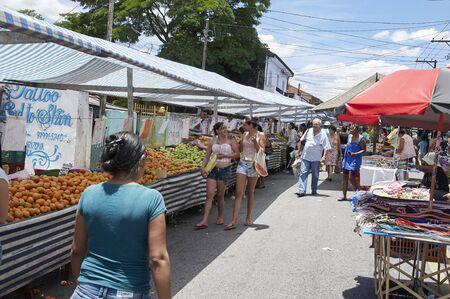 ensuring: SAO PAULO, BRAZIL - DECEMBER 2: Traditional street fair of Sao Paulo city , ensuring the supply of fresh foods, on December 2, 2014 in Sao Paulo. Stock Photo