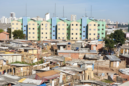 conglomeration: Slum and building popular in Sao Paulo. Illegal and fragile constructions near housing financed by the government for the poorest people. Stock Photo
