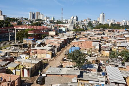 Slum and building popular in Sao Paulo. Illegal and fragile constructions near housing financed by the government for the poorest people. Stock Photo