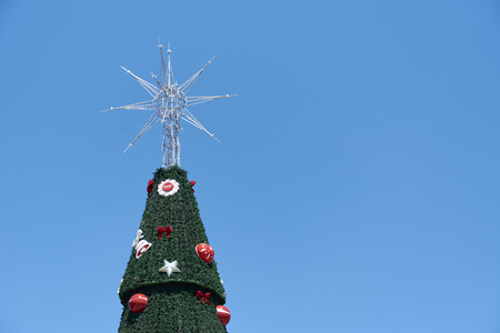 Sao Paulo, Brazil - December 6, 2016: Detail of traditional Christmas tree in Ibirapuera, being the 15th year of the attraction in the south zone of the city of Sao Paulo. With 35 meters of height, 16 meters of diameter and a star of 8 meters in the top. Stock Photo