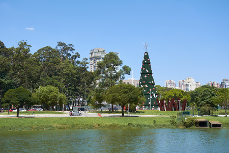 diameter: Sao Paulo, Brazil - December 6, 2016:Traditional Christmas tree in Ibirapuera, being the 15th year of the attraction in the south zone of the city of Sao Paulo. With 35 meters of height, 16 meters of diameter and a star of 8 meters in the top.