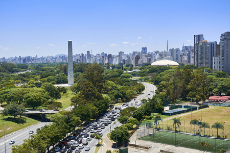 View of Ibirapuera Park, obelisk and building of the city of Sao Paulo in sunny afternoon.