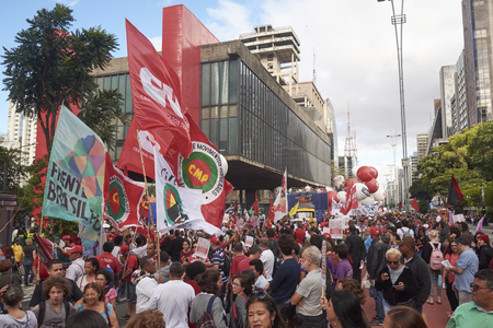 Sao Paulo, Brazil - March 31, 2017: Protest of workers against President Michel Temer, against social security reform, against corruption and against the reduction of workers rights.