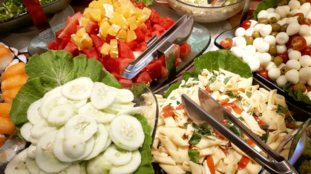 Typical Brazilian food, salad, pasta and tropical fruits served in restaurants at lunch or dinner. Imagens
