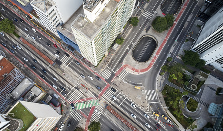 Sao Paulo, Brazil, top view of intersection between the Paulista avenue and Consolacao street , crosswalk and cityscape.