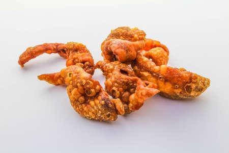 Fried chicken skin on white background photo
