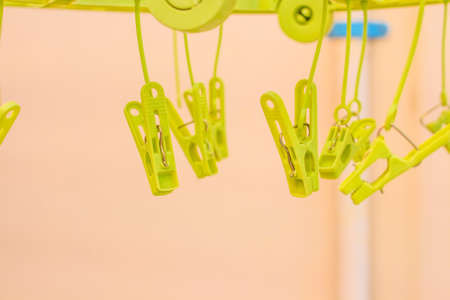 Row of Plastic Clothes pin clip photo
