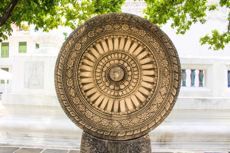 Wheel of Dharma in a sunny day photo