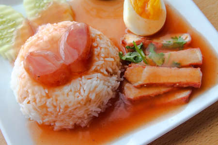Rice with roasted red pork photo