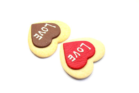 Heart shaped cookie with love text photo
