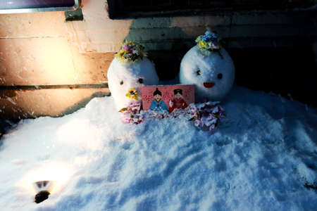 A couple of snowman are sleeping with Shoguns picture photo