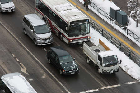 febuary: SAPPORO, JAPAN-FEBUARY 13 2015; Birdview of street  with cars driving. FEBUARY 13 2015, Sapporo, Japan Editorial