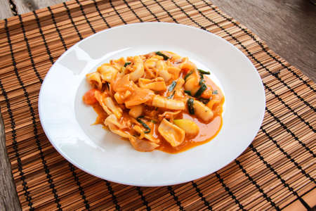 Stir Fried squid with salted egg york Stock Photo