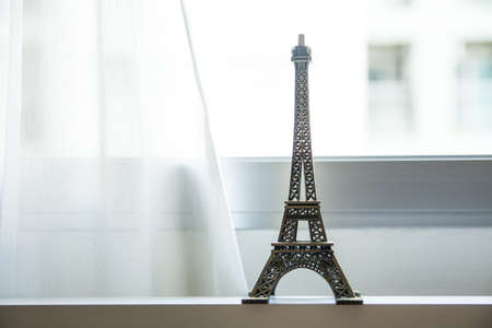 Eifel Tower Model with white curtain Фото со стока