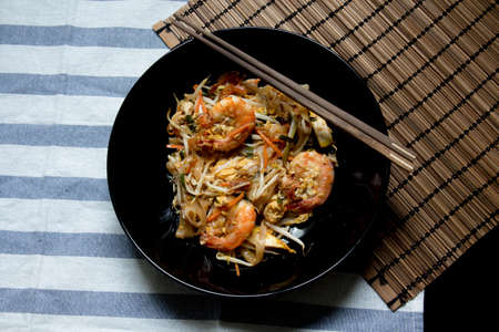 Pad Thai with wooden texture on background