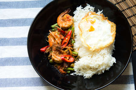 Stir fried prawn with red curry paste