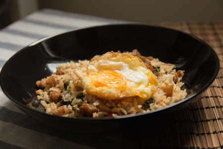Thai basil fried rice with fried egg.