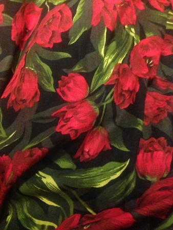 print: Red flower printed fabric.