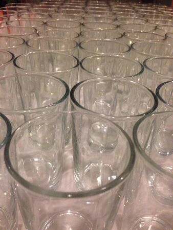 lined up: Nicely lined up clear drinking glasses with depth of field. Stock Photo