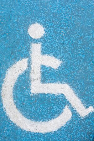 Wheelchair symbol in a Parking Lot Stock Photo