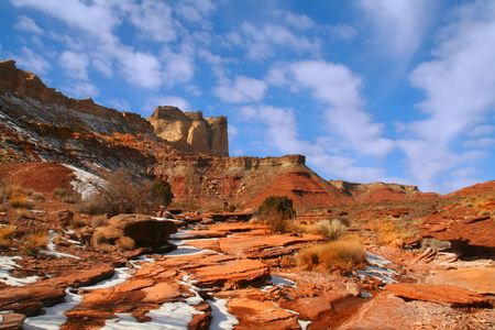 san rafael swell: View of the red rock formations in San Rafael Swell with blue sky�s and clouds