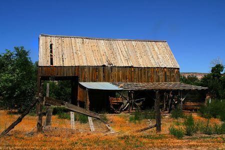 Old Hay Barn with trees and blue skys Stock Photo - 3229022