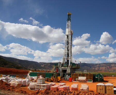 Drill rig in the Rocky Mountains with Blue Sky and Clouds
