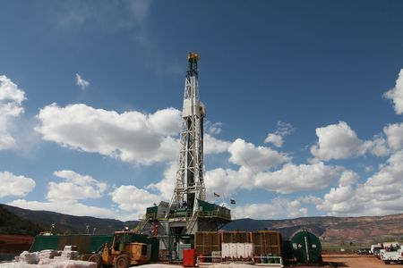 Oil rig in the RockyMountains with blue sky and clouds Stock Photo