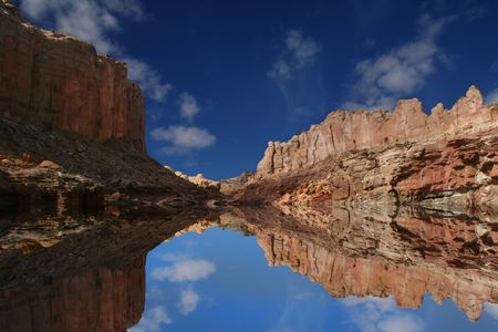 san rafael swell: View of the red rock formations in San Rafael Swell with blue sky�s  and reflections