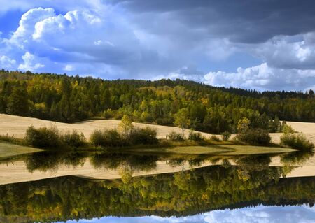 Storm in the mountains with reflections on water Stock Photo - 3629413