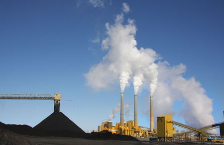 Coal Power Plant with smoke and blue sky photo