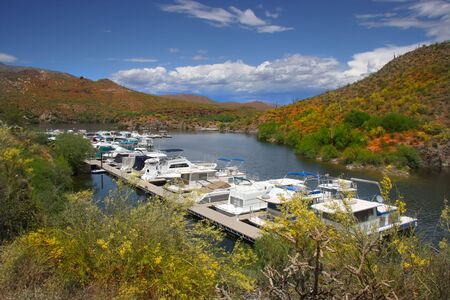 superstition:  Boat harbor  in the Superstition Mtns in Ariziona with clouds snd blue sky Stock Photo