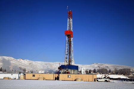 drill: Drill Rig with blue sky and snow