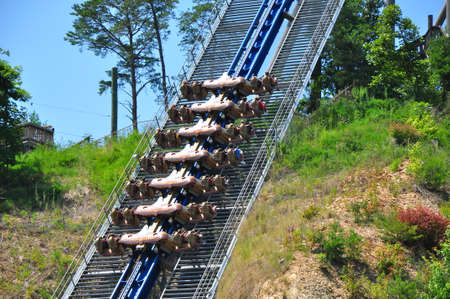 thrill: Rollercoaster Going Up Hill Stock Photo