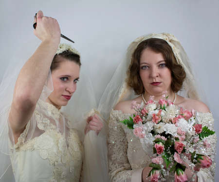One mad bride tries to stab the other with scissors