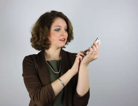 Pretty young businesswoman using cell phone Stock Photo - 25199812
