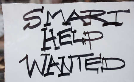 Smart Help Wanted  - Help wanted sign in window photo