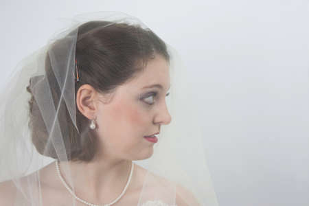 Profile of pretty young bride wearing veil photo