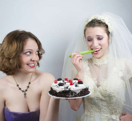 tempted: Bride trying to diet is tempted by bridesmaid
