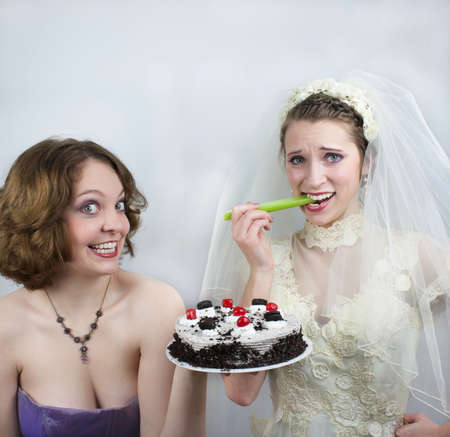 Bride trying to diet is tempted by bridesmaid photo