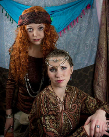 Two beautifiul young women dressed as a gypsys