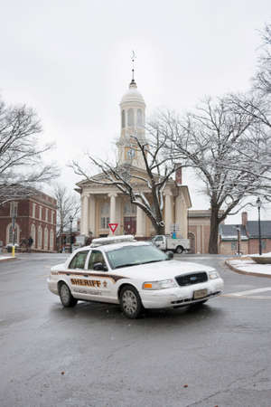 Fauquier County Sheriff car in front of the courthouse in historic Warrenton, Virginia in the snow
