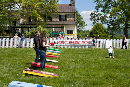 Delaplane, Virginia, USA-May 24, 2014  People playing corn hole at the Delaplane Strawberry Festival at Sky Meadows State Park in Delaplane, Virginia  Editorial