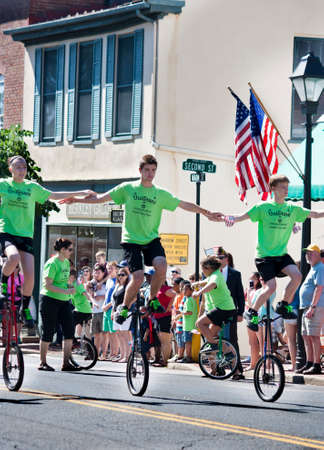 The Unistars Unicycling Showtroupe performing in the Memorial Day Parade