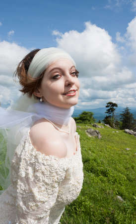 Young bride with long on mountain top