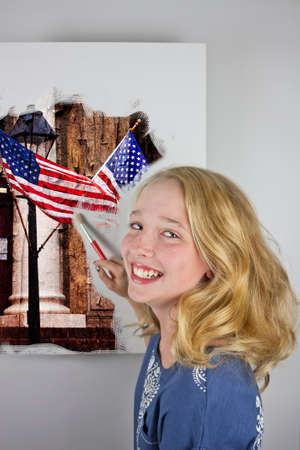 Cute blond girl wearing blue painting American flag Stock Photo