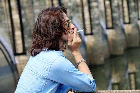 passions: Rough & tough guy male Wear sunglass smoking Stock Photo