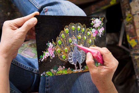 flaunt: Artist drawing peacock