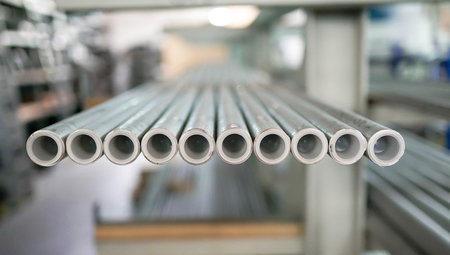 The Pipes Tube Factory Warehouse Shelfs Products. Plastic pipes laid in a row